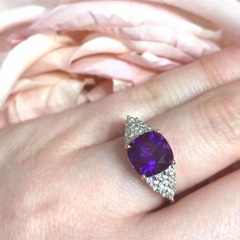 This attractive ring features a cushion cut amethyst set in the c