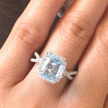 This beautiful 14k white gold aquamarine engagement ring featuring a natural emerald cut light blue
