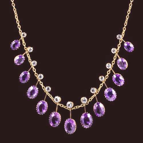 A spectacular antique Victorian necklace featuring a line of fabulous droppers each crowned with a
