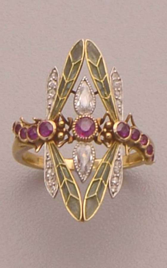 An Art Nouveau gold, plique-a-jour enamel, diamond and ruby ring. Designed as two dragonflies with