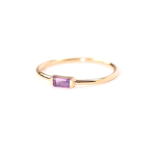 DESCRIPTION A touch of  Amethyst on a dainty Gold band. DETAILS - Baguette Cut Amethyst 4 x 2 mm