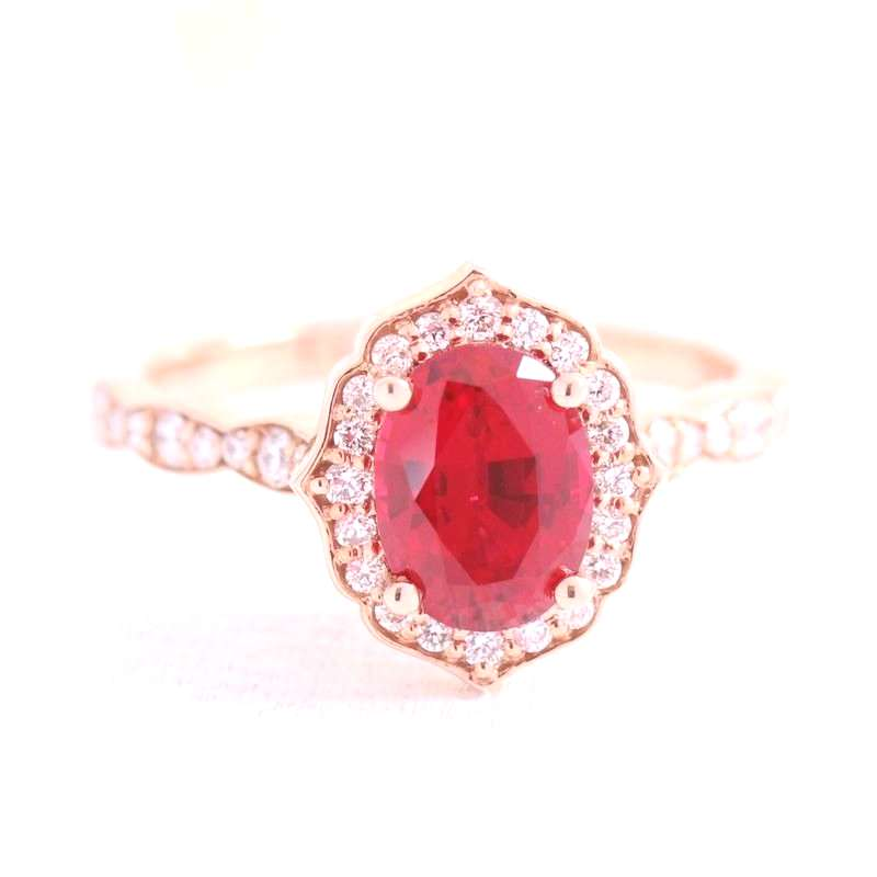 Gorgeous ruby engagement ring set in rose gold vintage floral diamond ring setting features an oval