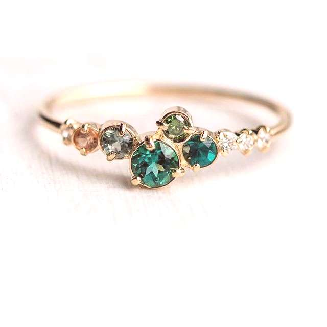 New! Trellis in Giverny ring with a cluster of green gemstones champagne diamonds and a peach sapph