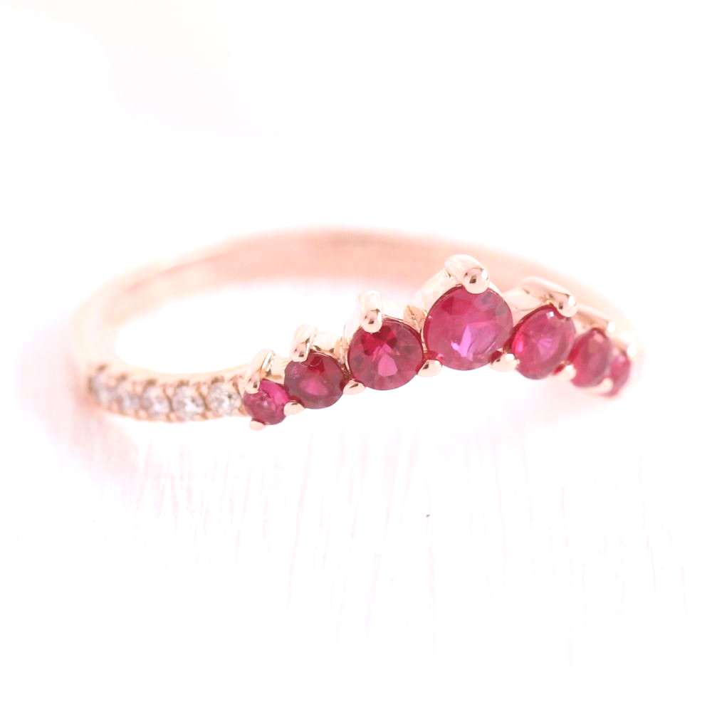 One of a kind ruby wedding ring features 7 conflict free natural ruby set in rose gold curved pave