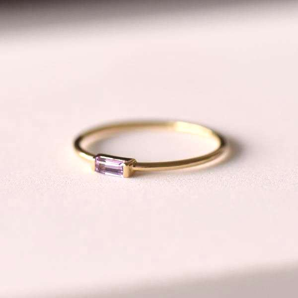 Sienna provides a perfect touch of color on a dainty 14K Gold filled band. Featuring a baguette cut