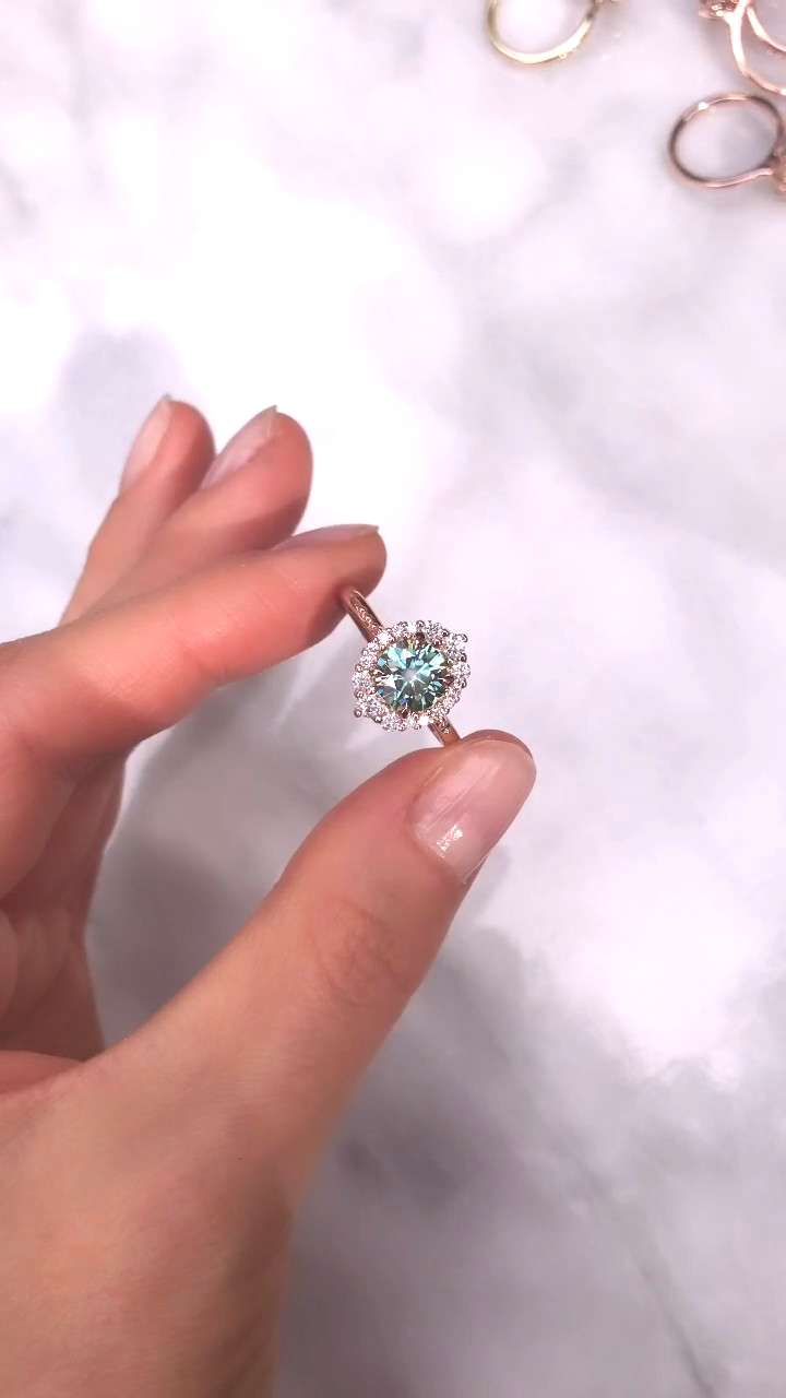 The Emerson Halo Engagement Ring This vintage-inspired halo ring features an aqua-teal Iconic Mois